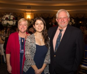 Emily Zabudoski (center) with parents Peter (right) and Jeanne (left). Photo credit Jim Lopes.
