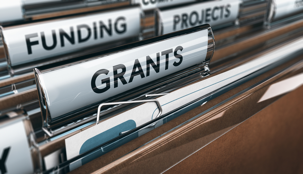 Files in cabinet titled grants, funding, projects
