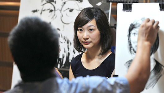 An artist drawing a woman's face