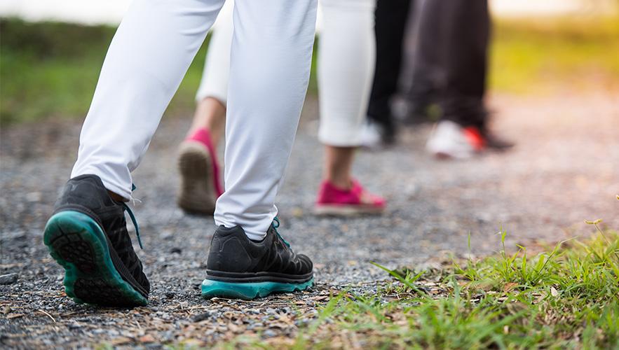 people in sneakers walking