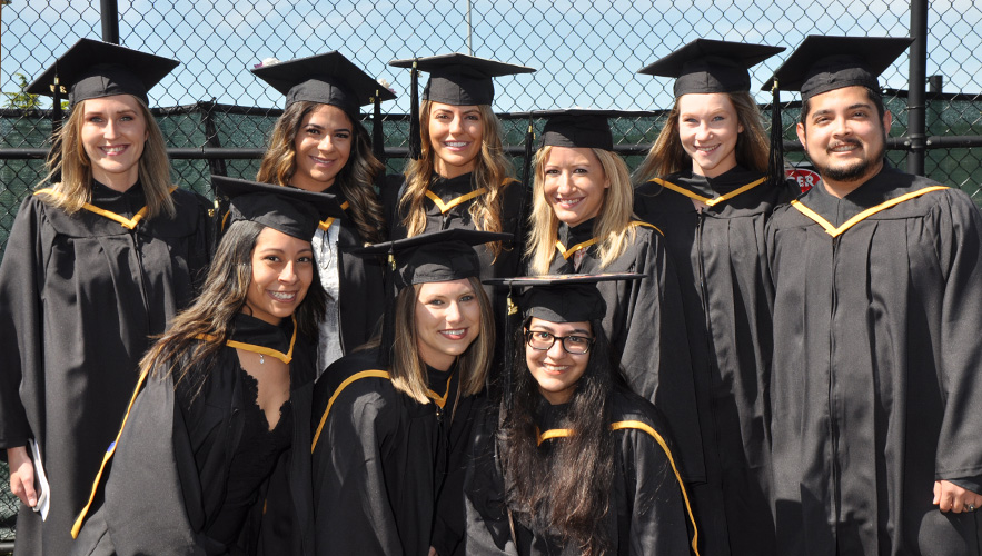 students in commencement regalia