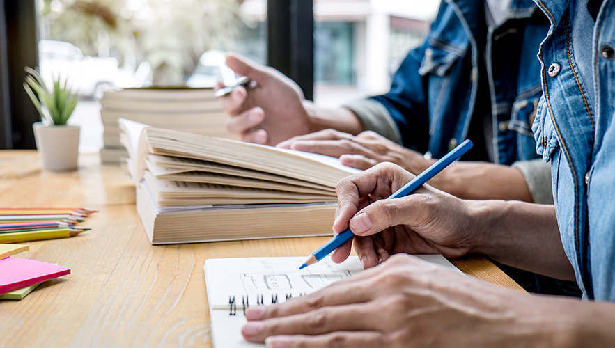 two people reading and writing