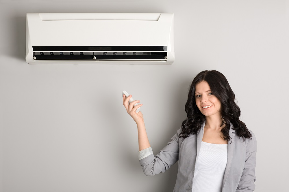 woman with air conditioner