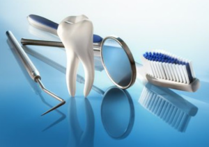 Dental hygiene tools next to a tooth.