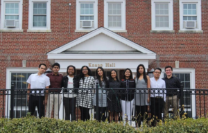 Students taking group photo outside of Knapp Hall.