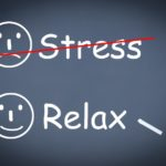 Words stress and relax with frowning face next to stress and smiling face next to relax. Red line is crossing out stress and face.