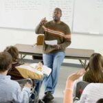 teacher in front of class Trusty