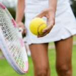 woman with tennis racquet and ball 2